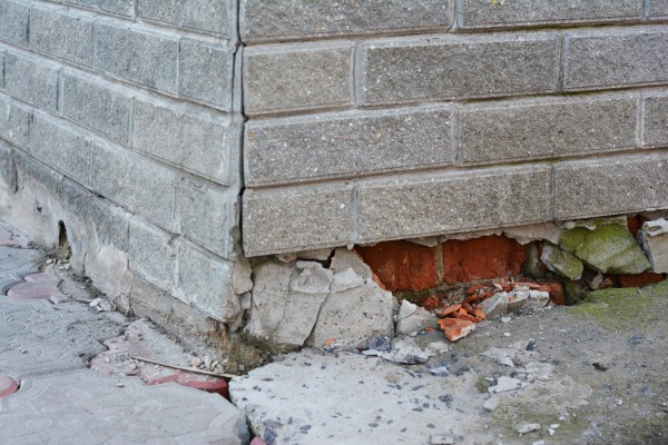 Foundation of a brick house in need of repair