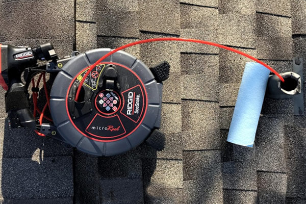 Plumbing camera being used on a residential roof
