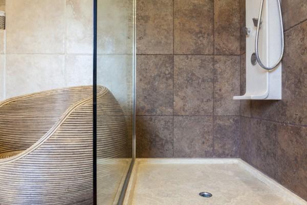 Porcelain shower base in a bathroom